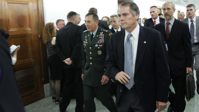 U.S. Army Gen. David Petraeus, center, current Commander of International Security Assistance Force (ISAF), and Commander of U.S. Forces Afghanistan leaves a meeting with Senate Intelligence Committee chair Sen. Dianne Feinstein, D-Calif., on Capitol Hill in Washington, Wednesday, June 15, 2011. (AP Photo/Charles Dharapak)