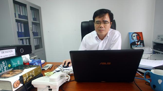 Le Quoc Quan, one of Vietnam's better-known dissidents and a leading blogger, works at his office in Hanoi, Vietnam on Friday, Sept. 28, 2012. The Internet has become the principal staging ground for dissent in Vietnam, and its Communist rulers are trying to clamp down with new laws, stepped up arrests, intimidation and longer prison sentences. But so far, it's a battle they are losing. (AP Photo/Na Son Nguyen)