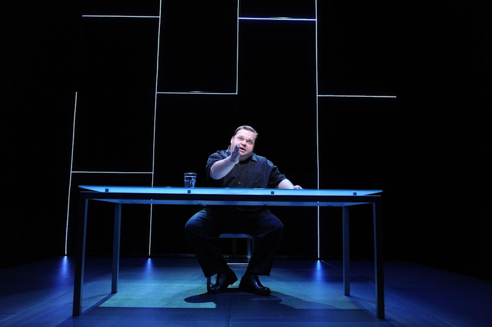 "In this undated image released by The Public Theater, Mike Daisey is shown in a scene from ""The Agony and The Ecstasy of Steve Jobs,"" running at The Public Theater in New York from Oct. 11 to Nov. 13. (AP Photo/The Public Theater, Stan Barouh)"