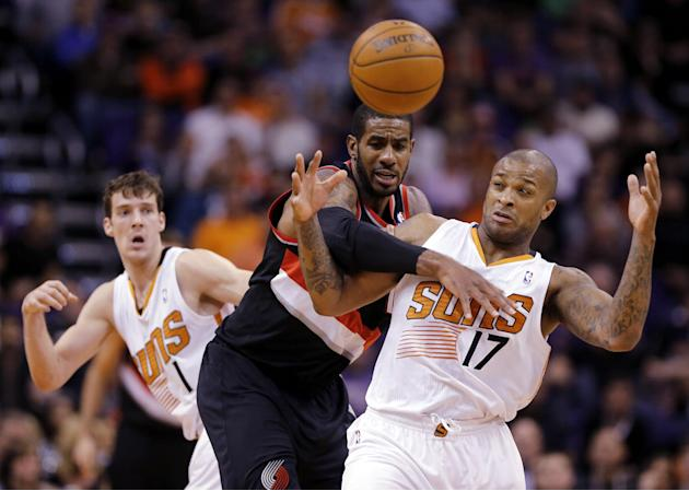 Phoenix Suns' P.J. Tucker (17) is fouled by Portland Trail Blazers' LaMarcus Aldredge as Suns' Goran Dragic, of Slovenia, rear, watches during the second half of an NBA basketball game, Wednesday, Nov
