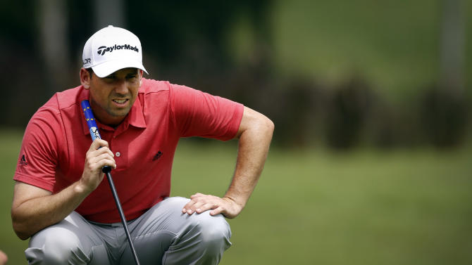 Moore takes 2-shot lead at CIMB Classic