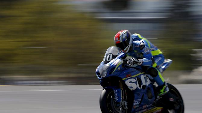 Suzuki rider Philippe of France competes during the 38th Le Mans 24 Hours motorcycling endurance race in Le Mans