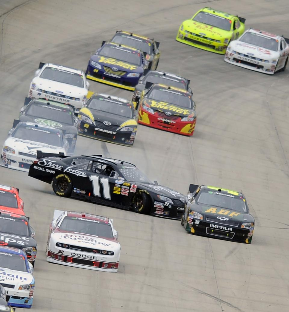 Driver Brian Scott (11) gets sideways during the NASCAR Nationwide series 5-hour ENERGY 200 auto race, Saturday, May 14, 2011, at Dover International Speedway in Dover, Del. (AP Photo/Nick Wass)