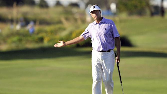 Davis Love III reacts to his putt on the 18th green during the second round of the McGladrey Classic PGA Tour golf tournament on Friday, Oct. 19, 2012, in St. Simons Island, Ga. (AP Photo/Stephen Morton)