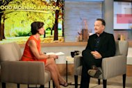"This image released by ABC shows actor Tom Hanks during an interview segment with Elizabeth Vargas on ""Good Morning America,"" Friday, Oct. 19, 2012 in New York. ABC and Tom Hanks are apologizing after the actor let slip a swear word during a live appearance on ""Good Morning America."" Hanks telegraphed his ""f-bomb"" during an interview Friday. Vargas had asked him to speak in his character's British accent in the movie ""Cloud Atlas."" Hanks said that it was ""mostly swear words,"" but Vargas told him to go ahead anyway. He began speaking in a mumble but the obscenity was clearly audible. ABC removed it for subsequent feeds of the show in the Midwest and West. (AP Photo/ABC, Fred Lee)"