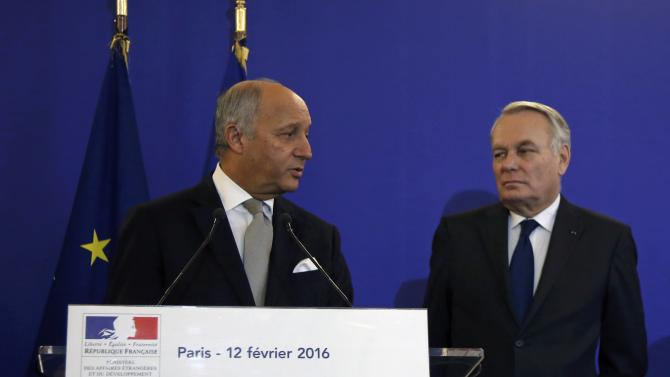 Outgoing French Foreign Minister Laurent Fabius delivers a speech next to newly-appointed Foreign Minister Jean-Marc Ayrault during the official handover ceremony at the Quai d'Orsay in Paris