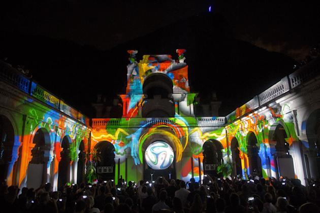 In this Tuesday, Dec. 3, 2013, an image of Brazuca, the official 2014 World Cup soccer ball, is projected during a 3D presentation at its unveiling in Rio de Janeiro, Brazil. The eyes of soccer focuse