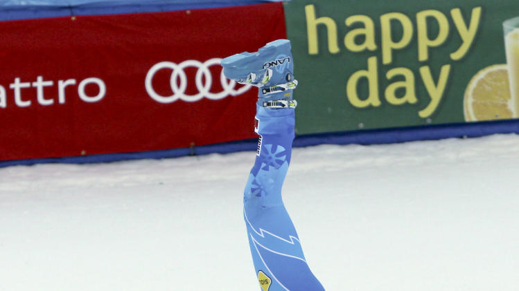 CORRECTS DAY AND DATE - Tina Maze, from Slovenia, does a cartwheel in the finish arena after winning the women's World Cup giant slalom race in Aspen, Colo., on Saturday, Nov. 24, 2012. (AP Photo/Alessandro Trovati)