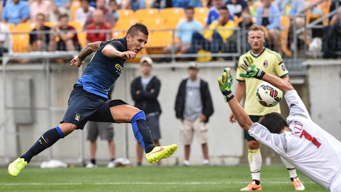 Manchester City's Stevan Jovetic scores past AC Milan goalkeeper Michael Agazzi during the match at Heinz Field in Pittsburgh on July 27, 2014