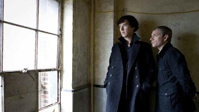 "This image released by PBS shows Benedict Cumberbatch as Sherlock, left, and Martin Freeman as Watson are shown in the ""Sherlock: A Scandal in Belgravia"". Cumberbatch was nominated Thursday, Dec. 13, 2012 for best actor in a TV movie or miniseries for his role in the film. The 70th annual Golden Globe Awards will be held on Jan. 13. (AP Photo/PBS-Hartwood Films for the BBC, Colin Hutton)"