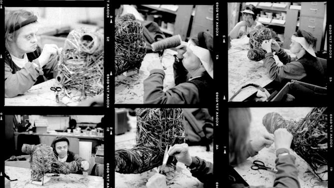 "This 1999 photo contact sheet provided the Brooklyn Museum shows artist Judith Scott working on one of her cocoon-like fiber sculptures at the Creative Growth Art Center in Oakland, Calif. Scott, who died in 2005, was born with Down syndrome and was deaf and mute. She was institutionalized for 35 years until she was introduced to the Creative Growth Art Center and its program for artists with developmental disabilities. She's now getting her first solo museum exhibition in the United States. ""Bound and Unbound"" opens Friday, Oct. 24, 2014 at the Brooklyn Museum. (AP Photo/Brooklyn Museum, Leon Borensztein)"