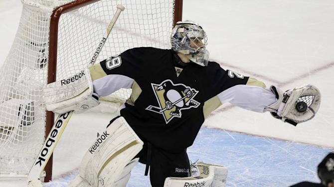 Pittsburgh Penguins goalie Marc-Andre Fleury makes a glove save in the third period of Game 1 of an NHL hockey Stanley Cup first-round playoff series against the New York Islanders on Wednesday, May 1, 2013, in Pittsburgh. The Penguins won 5-0. (AP Photo/Gene J. Puskar)