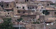 An image grab taken from a video released by the United Nations Supervision Mission in Syria (UNSMIS) shows shelled houses in the central flashpoint city of Homs