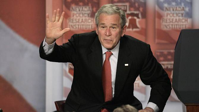 FILE - In this Jan. 31, 2008, file photo President Bush waves after signing a 15-day extension of the Protect America Act after a speech in Las Vegas. Sternly prodding Congress,  Bush told lawmakers they were jeopardizing the nation's safety by failing to lock in the government eavesdropping law. When the Protect America Act made warrantless wiretapping legal, lawyers and executives at major technology companies knew what was about to happen. They didn't know that its passage gave birth to a top-secret NSA program, officially labeled US-98XN. It was known as Prism. (AP Photo/Jae C. Hong, File)