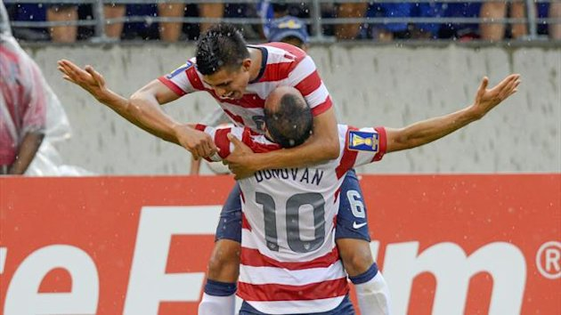 Landon Donovan is embraced by teammate Joe Corona after scoring a goal during the second half of their CONCACAF Gold Cup quarter-final match against El Salvador in Baltimore (Reuters)