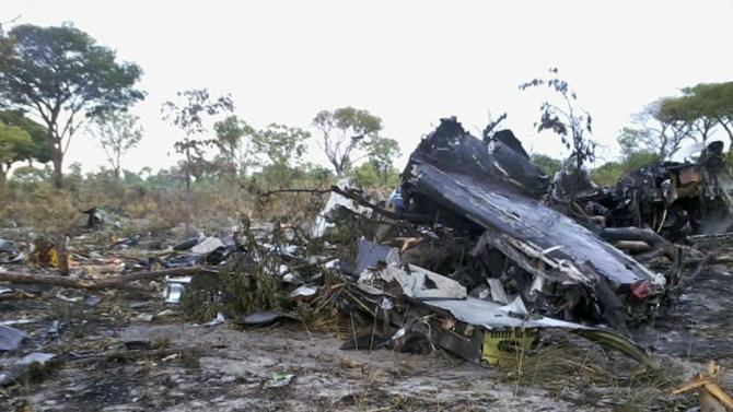 "FILE - This Saturday, Nov. 30, 2013 file photo, shows the wreckage of a Mozambique Airlines plane which crashed Nov. 29, in the Bwabwata National Park, Namibia, killing all 27 passengers and six crew on board. Preliminary investigations shows that the pilot intentionally brought the Mozambican plane down ""There was an intention to crash the plane,"" Joao Abreu, chairman of the Mozambican Civil Aviation Institute said Saturday Dec. 21, 2013. (AP Photo/NAMPA, Olavi Haikera, FILE)"