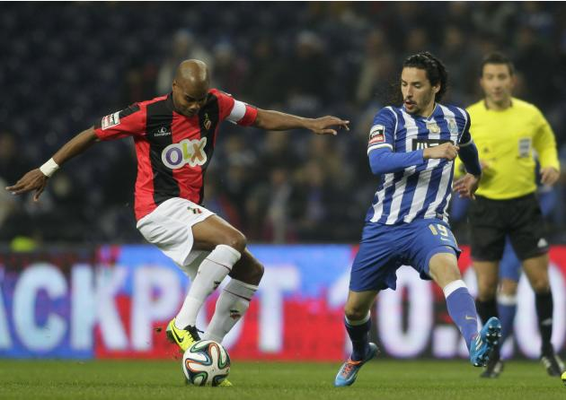 Porto's Carneiro challenges Olhanense's Celestino during their Portuguese Premier League soccer match at Dragao stadium in Porto