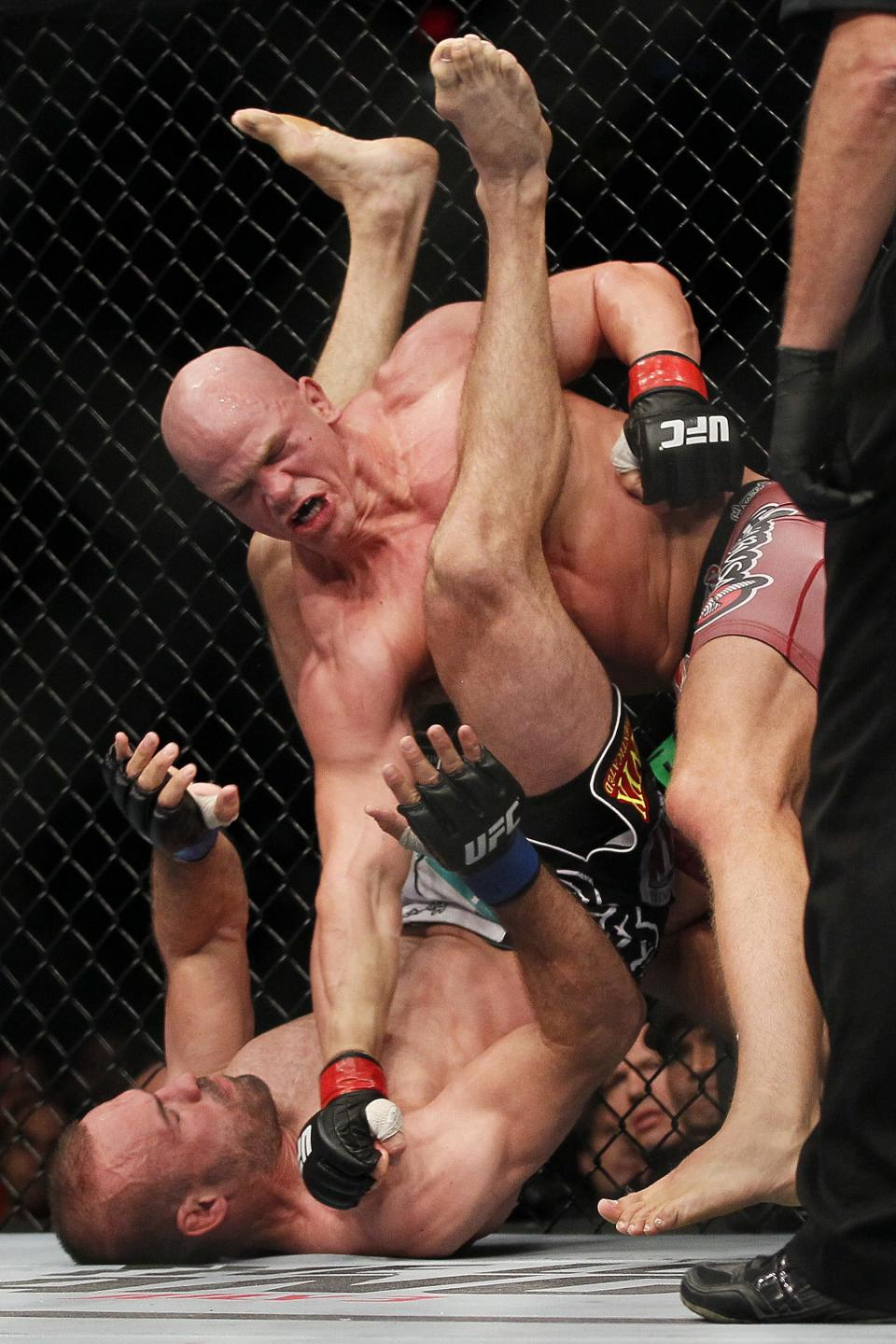 Ryan Jimmo, right, lays into Igor Pokrajac during during their light heavyweight bout at UFC 161 in Winnipeg on Saturday June 15, 2013. (AP Photo/The Canadian Press, John Woods)