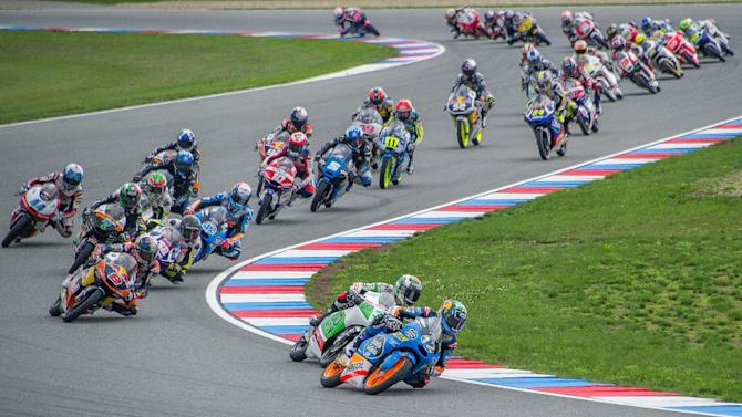 Estrella Galicia 0,0's Spanish rider Alex Marquez leads pack of riders during the Czech Republic's Grand Prix in Moto 3 on August 17, 2014, in Brno, Czech Republic