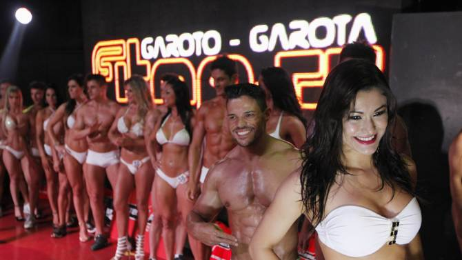 Participants line up as they compete during the Boy and Girl Fitness Sao Paulo City 2013 contest, in Sao Paulo