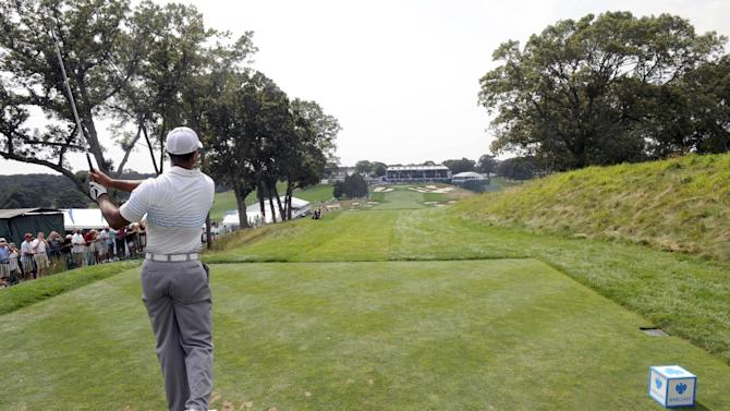 Tiger Woods hits his tee shot on the 18th hole during Pro-Am for The Barclays golf tournament at Bethpage State Park in Farmingdale, N.T. , Wednesday, Aug. 22, 2012. (AP Photos/Henny Ray Abrams)