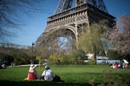 People have picnic on the grass of the Champs de Mars in Paris, on March 26, 2012. According to studies on asexuality, people who have no or little sexual appetite could make up one percent of the global population