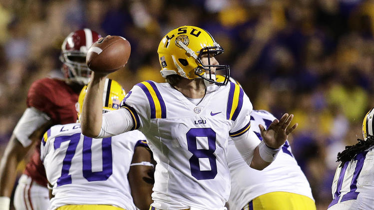 LSU quarterback Zach Mettenberger (8) passes in the first half of an NCAA college football game against Alabama in Baton Rouge, La., Saturday, Nov. 3, 2012. (AP Photo/Bill Haber)