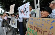 Protesters stage a demonstration against the arrival of the US military's Osprey aircraft, in front of the prime minister's official residence in Tokyo in July 2012. The United States said Friday it would delay flights of its Osprey aircraft in Japan until it wins the confidence of its close ally after protests by residents concerned over crashes