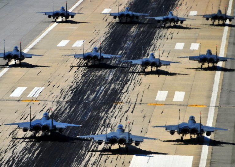 US F-15E Strike Eagles of the 4th Fighter Wing taxi down a runway on Seymour Johnson Air Force Base on April 16, 2012