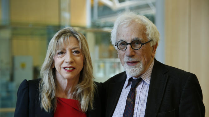 """Joe Herbert, right, Emeritus Professor of Neuroscience at the University of Cambridge and Barbara Sahakian, left, professor of Clinical Neurophychology at the same university, pose for the photographer prior to a news conference to announce the results of a new study in central London, Monday, Feb. 17, 2014. A saliva test for teenage boys with mild symptoms of depression could help predict those who will later develop major depression, the new study says. Researchers who measured cortisol levels in teenagers found that boys with high levels of the hormone and mild depression symptoms were 14 times more likely to later suffer from clinical depression than those with low levels. Herbert said: """"You don't have to rely simply on what the patient tells you, but what you can measure inside the patient,"""" comparing the new test to those done for other health problems, like heart disease, which evaluate things like cholesterol and high blood sugar to determine a patient's risk. (AP Photo/Lefteris Pitarakis)"""