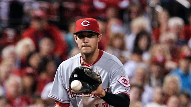 Cincinnati Reds second baseman Kris Negron fields a ball hit by St. Louis Cardinals' Matt Holliday during the seventh inning of a baseball game Sunday, Sept. 21, 2014, in St. Louis. Holliday was out at first. The Reds won 7-2. (AP Photo/Sarah Conard)