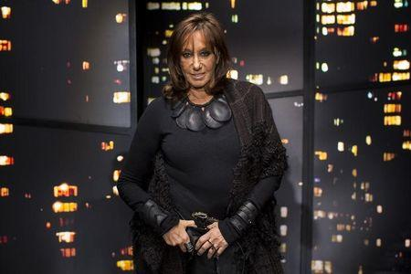 Designer Donna Karan poses for a portrait before presenting the Donna Karan New York Fall/Winter 2015 collection at New York Fashion Week