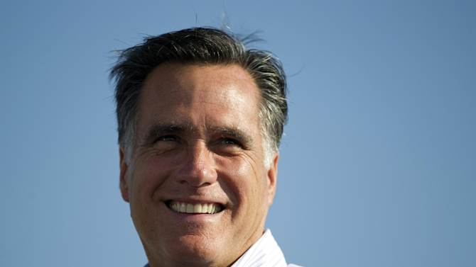 FILE - In this June 19, 2012, file photo Republican presidential candidate, former Massachusetts Gov. Mitt Romney campaigns in Holland, Mich. Romney privately raised millions of dollars from New York's elite on Sunday, July 8, 2012, as Democrats launched coordinated attacks against the likely Republican presidential contender, intensifying calls for him to explain offshore bank accounts and release several years of tax returns.  (AP Photo/Evan Vucci, File)
