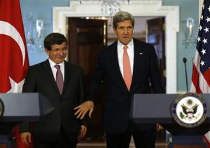 U.S. Secretary of State Kerry and Turkish Foreign Minister Davutoglu arrive to speak to reporters at State Department in Washington