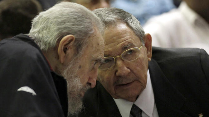Cuba's leader Fidel Castro and his brother  Cuba's President Raul Castro talk during the opening session of the National Assemby in Havana, Cuba, Sunday, Feb. 24, 2012.  Cuba's parliament reconvened Sunday with new membership and was expected to name Raul Castro to a new five-year-term as president. Raul Castro fueled speculation on Friday when he talked of his possible retirement and suggested he has plans to resign at some point.(AP Photo/Ismael Francisco, Cubadebate)