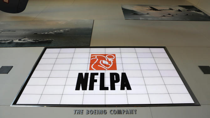 A general view of the NFLPA logo is seen on a video board during the NFLPA Legends Brunch at the National World War II Memorial Museum on Sunday February 3, 2013 in New Orleans, Louisiana. (Aaron M. Sprecher/AP Images for NFLPA)