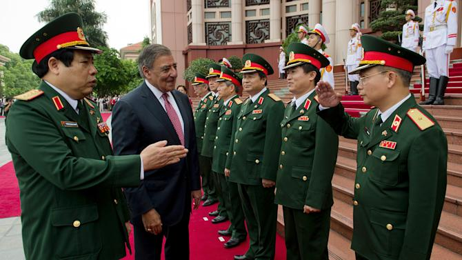 U.S. Defense Secretary Leon Panetta, second left, participates in an arrival ceremony with Vietnamese Defense Minister Phung Quang Thanh, left, at the Ministry of Defense in Hanoi, Vietnam Monday, June 4, 2012. (AP Photo/Jim Watson, Pool)