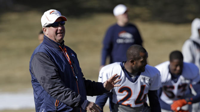 Denver Broncos head coach John Fox instructs players at football practice at the team's training facility in Englewood, Colo., on Wednesday, Jan.9,  2013. The Broncos are scheduled to play the Baltimore Ravens in an NFL playoff game on Saturday. (AP Photo/Ed Andrieski)
