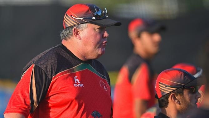 Afghanistan's coach Andy Moles (L) directs players during a final training session ahead of the 2015 Cricket World Cup Pool A match between Australia and Afghanistan in Perth on March 3, 2015