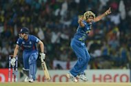 Sri Lanka's Lasith Malinga (R) celebrates the wicket of Alex Hales during the Twenty20 World Cup Super Eights match with England at the Pallekele International Cricket Stadium on Monday. England, the defending champions, crashed out of the tournament in a 19-run defeat