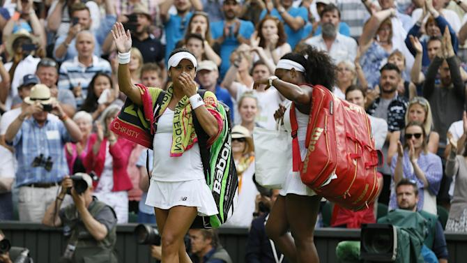 Heather Watson of Britain, left, waves as she leaves the court after losing to Serena Williams of the United States in their singles match at the All England Lawn Tennis Championships in Wimbledon, London, Friday July 3, 2015. (AP Photo/Kirsty Wigglesworth)