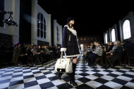 <p>               The Tommy Hilfiger Fall 2013 collection is modeled during Fashion Week in New York, Sunday, Feb. 10, 2013.  (AP Photo/Seth Wenig)