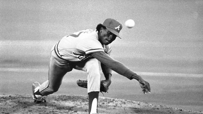 FILE - In this May, 8, 1984, file photo, Atlanta Braves' Pascual Perez delivers a pitch on his way to earning a victory against the Philadelphia Phillies during a baseball game in Philadelphia. Police in the Dominican Republic say the former major league pitcher has been killed in his home during an apparent robbery. (AP Photo/Amy Sancetta, File)