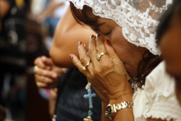 Dionisia Pacquiao (C), Mother Of Philippine Boxing Icon Manny Pacquiao, Prays At A Church In General Santos City, In  AFP/Getty Images