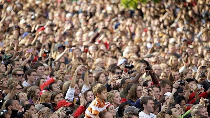 Tyler Kuhn, 7, of Madison, Wis., sits atop a friends shoulder as he watches President Barack Obama speak at the University of Wisconsin-Madison during a campaign stop in Madison, Wis., Thursday, Oct. 4, 2012.  (AP Photo/Andy Manis)