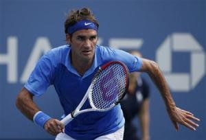 Federer of Switzerland chases down a return to Berlocq of Argentina at the U.S. Open tennis championships in New York