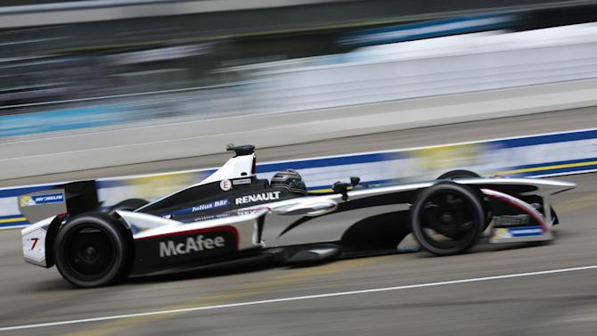 Jerome D'Ambrosio from Belgium drives his car during the qualifying session at the Formula E Berlin ePrix auto race, at the former airport Tempelhof, in Berlin, Germany, Saturday, May 23, 2015. (AP Photo/Markus Schreiber)