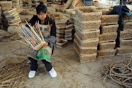 A woman weaves rattan baskets for sale at a shop in Hefei, east China&#39;s Anhui province in June 2012. China&#39;s exports for June were $180.21 billion, up 11.3 percent year-on-year, while imports rose 6.3 percent to reach $148.48 billion, the General Administration of Customs said in a statement