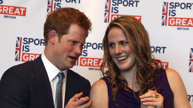 Britain's Prince Harry talks with Olympic gold medalist Missy Franklin at a reception at the Sanctuary Golf Course in Sedalia, Colo., south of Denver on Friday, May 10, 2013. (AP Photo/Ed Andrieski, Pool)
