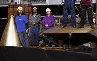 Workers lisen as U.S. President Barack Obama speaks at Newport News Shipbuilding in Newport News, Virginia February 26, 2013. REUTERS/Kevin Lamarque